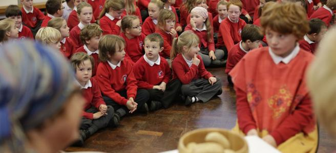 Pupils participate in an Open The Book assembly